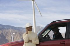 Mature Woman By Truck At Wind Farm Royalty Free Stock Photography