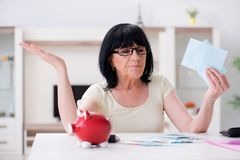 The mature woman trying to reconcile her bills. Mature woman trying to reconcile her bills Royalty Free Stock Photos