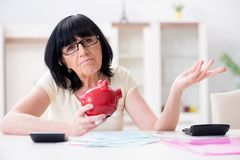 The mature woman trying to reconcile her bills. Mature woman trying to reconcile her bills Royalty Free Stock Photography