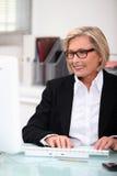 Mature woman typing Stock Photo