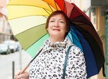 Mature woman with umbrella Stock Image