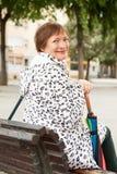 Mature woman with umbrella Royalty Free Stock Photos