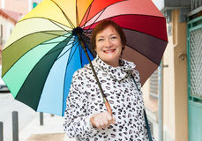 Mature woman with umbrella Royalty Free Stock Photo