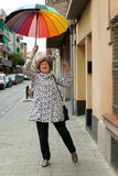 Mature woman with umbrella Stock Photos