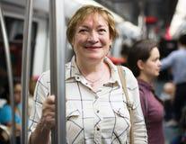 Mature woman underground passenger Royalty Free Stock Image
