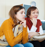 Mature woman and unhappy  daughter having problems Royalty Free Stock Photo