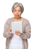 Mature woman use of tablet pc Stock Images