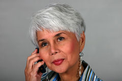 Mature woman using a cell phone Stock Image