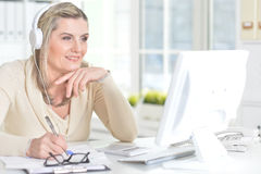 Mature woman using computer Stock Image