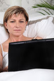 Mature woman using a laptop Stock Photo
