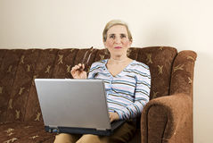 Mature woman using laptop home Royalty Free Stock Photography