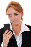 Mature woman using mobile Royalty Free Stock Photos