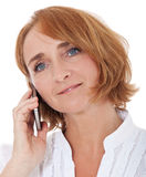 Mature woman using mobile Royalty Free Stock Photo