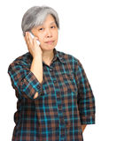 Mature woman using mobile phone Royalty Free Stock Photo