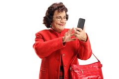 Mature woman using a mobile phone stock photo