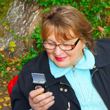 Mature woman using phone stock images