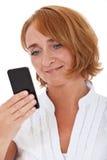 Mature woman using smart phone Royalty Free Stock Photo