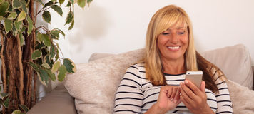 Mature Woman Using a Smartphone Royalty Free Stock Photo