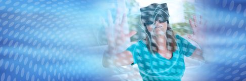 Woman using a virtual reality headset, light effect; panoramic banner. Mature woman using a virtual reality headset, light effect; panoramic banner stock photo