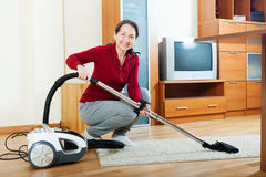 Mature woman with vacuum cleaner Stock Photos