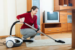 Mature woman with vacuum cleaner Stock Photography