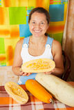 Mature woman with vegetable marrow Stock Image