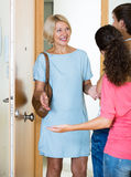 Mature woman visiting adult kids at their place Royalty Free Stock Photos