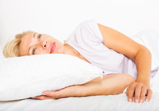 Mature woman  waking on bed Royalty Free Stock Photography