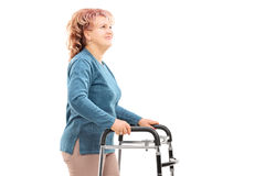 Mature woman with walker looking up Stock Images