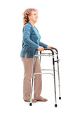 Mature woman with walker looking up Royalty Free Stock Images