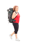 Mature woman walking with backpack Royalty Free Stock Photo