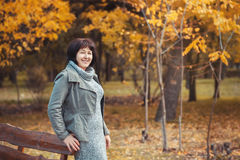 Mature woman is walking in the pak and smilling Royalty Free Stock Photo