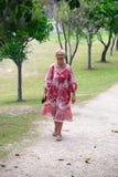 Mature woman walking in park Stock Photos