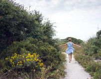 Mature Woman Walking Path to the Beach stock image