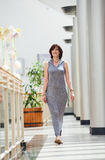 Mature woman walking at the shopping center Royalty Free Stock Photography