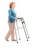 Mature woman walking with walker Royalty Free Stock Photo