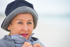 Mature woman in warm jumper in cold weather Royalty Free Stock Photography
