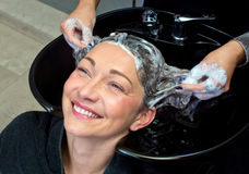 Mature woman washing hair Stock Photo