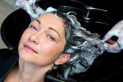 Mature woman washing her hair Stock Photos