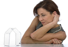 Mature woman watching transparent little house Royalty Free Stock Images