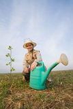 Mature woman with watering can Stock Images