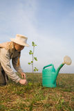 Mature woman with watering can Stock Photo