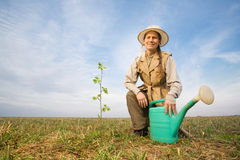 Mature woman with watering can Royalty Free Stock Photo