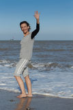Mature woman waving from the sea Royalty Free Stock Photo