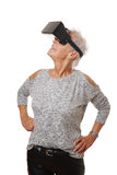 Mature woman wearing VR headset experiencing virtual reality Stock Photography