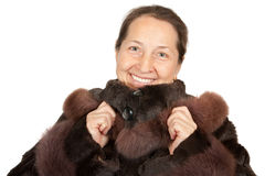 Mature woman wearing a winter coat Royalty Free Stock Image