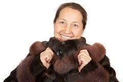 Mature woman wearing a winter coat. Portrait of elegant senior lady in  fur coat Royalty Free Stock Image