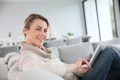 Mature woman websurfing with tablet at home Stock Photo