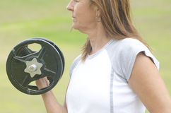 Mature woman weight lifting outdoor Royalty Free Stock Image