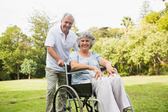 Mature woman in wheelchair with partner Royalty Free Stock Images